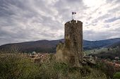 The Old Castle Towers Over The City In A Mountainous Area. There Are Tower And Wall Ruins. The Tower poster