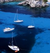 stock photo of sail ship  - Four sail boats in the waters of Paleokastritsa Corfu Greece - JPG