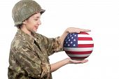 A Pretty Young Woman In Ww2 Uniform Us Showing Sphere Of American Flag poster