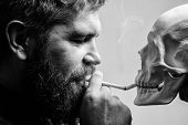 Man Smoking Cigarette Near Human Skull Symbol Death. Nicotine Destroy Health. Harmful Habits. Smokin poster