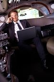 stock photo of limousine  - Handsome young businessman sitting in limousine - JPG