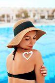 Woman Applying Sun Cream Creme On Tanned  Shoulder. Sun Protection.sun Cream. Skin And Body Care. Gi poster