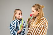 Pretty Appealing Girls With Light Hair Smelling Scent Of First Spring Tulips poster