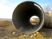 Old Rye Pipes Of Large Diameter Lie On The Ground. Pipeline. Large Iron Drainage Pipes Connect Two R poster