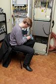 Network Engineer Measuring Fibre Optic