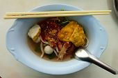 Yentafo Or Yen-ta-four, Thai-style Noodle Soup With Fishballs, Crispy Wonton Skin, And Special Homem poster