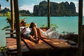 Loving Couple Resting In Asia. A Young Couple Travels To Exotic Countries. Man And Woman At The Reso poster