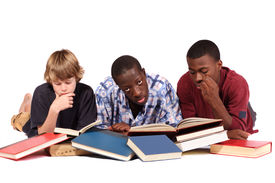 picture of teenage boys  - Two boys study while the boy in the middle has had enough - JPG