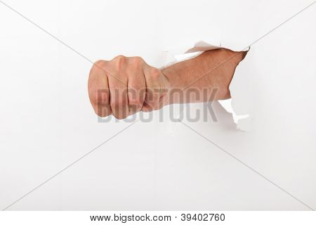 Human fist through the broken wall