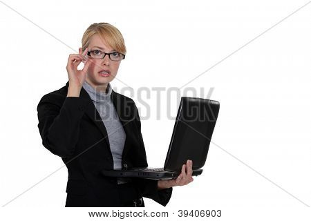 young bespectacled businesswoman working on laptop isolated on white