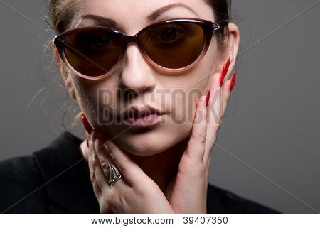 Close-up Portrait Of A Beautiful Woman Wearing Sunglasses