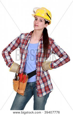 Serious woman with tools