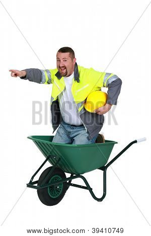 craftsman sitting in a wheelbarrow