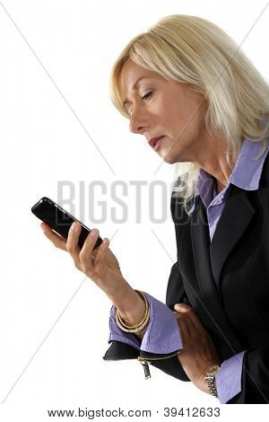 mature businesswoman holding a cell