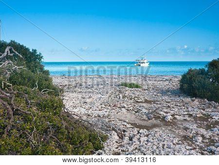 Boat Near The Island Iguanas. Cayo Largo. Cuba