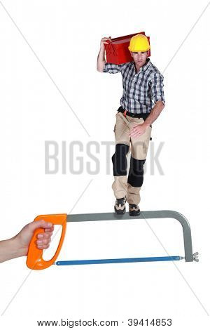 Heroic construction worker standing on a saw