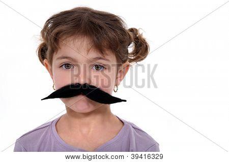 Little girl wearing a false mustache