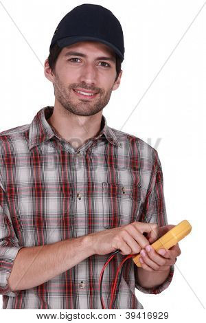 handsome electrician using tester