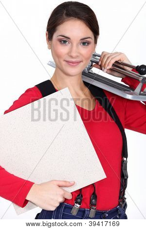Young woman with a tile cutter