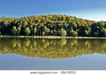 Idyllic Autumn Reflections On Lake Surface
