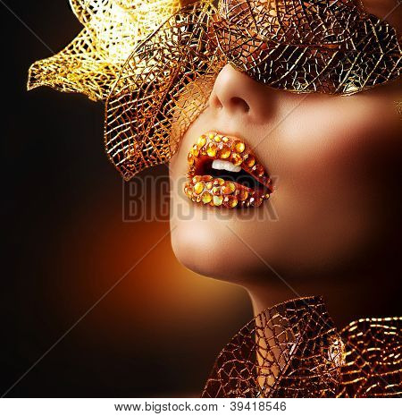 Luxury Golden Makeup. Beautiful Professional Holiday Make-up. Sexy Gold Lips.Fashion Art Portrait.Jewelry. Jewellery. Jewelery