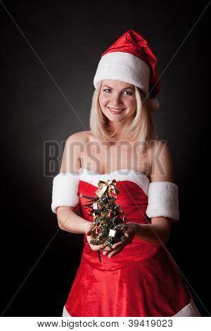 Santa girl with Christmas tree.