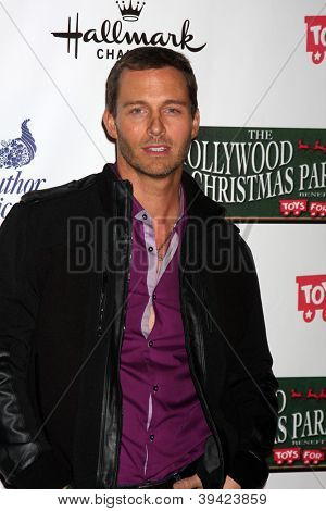 LOS ANGELES - NOV 25:  Eric Martsolf arrives at the 2012 Hollywood Christmas Parade at Hollywood & Highland on November 25, 2012 in Los Angeles, CA