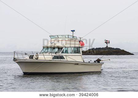 White Fishing Boat In Alaskan Waterway