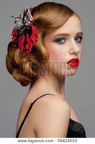 Portrait of attractive young woman with red lipstick and  beautiful hairstyle. Hairdo with beautiful hair decoration
