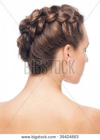 Portrait of young beautiful woman with creative braid hairdo. Rear view, isolated on white background