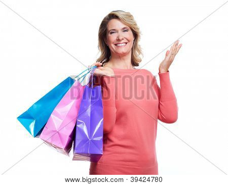 Senior woman with shopping bags. Isolated over white background.