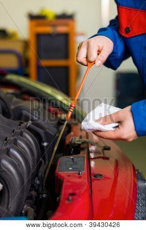 oil pressure is measured in the car. with the dipstick is the correct oil level checked