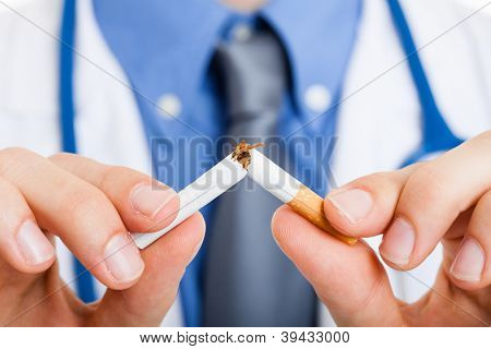 Doctor breaking a cigarette
