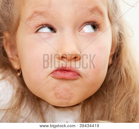 Grimacing child. Nescience little girl.