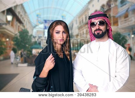 Arabian couple shopping