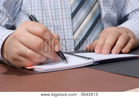 Close-Up Of A Businessman\'S Hand With A Pen Writing Something.
