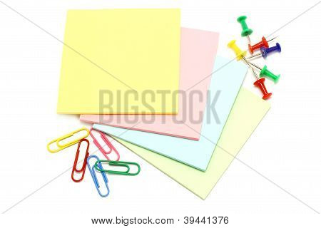Colour paper with drawing pins and clips