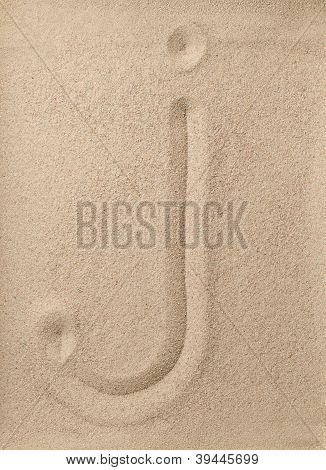 Letter j from sand