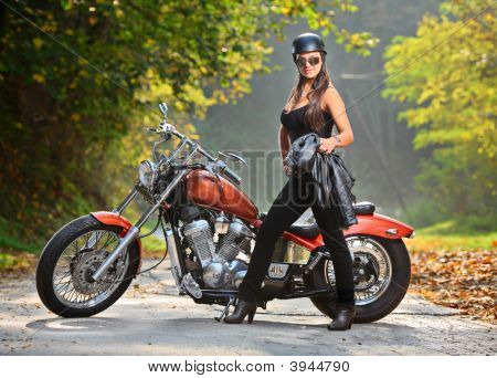 Biker Girl Standing Next To A Motorcycle