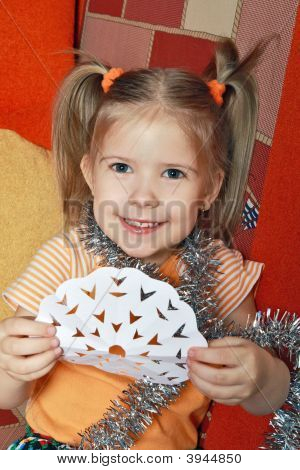 The Happy Girl With A Paper Snowflake