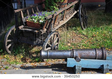 Wooden Cart And A Old Cannon