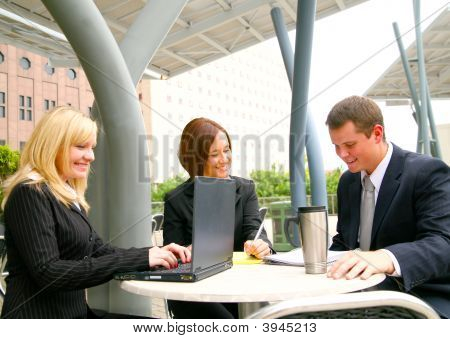 Three Busy Business People