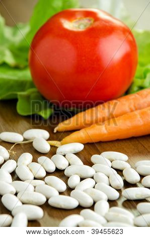 Uncooked White Beans And Fresh Vegetables
