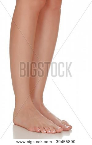 Female feet on white background