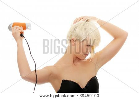 Young beautiful blond woman using hair drier