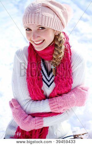 Portrait Of Happy Girl On The Snow