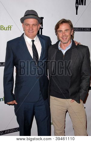 LOS ANGELES - NOV 27:  Mike O'Malley, Sam Trammell arrive at the 'Certainty' Los Angeles premiere at Laemmle Music Hall on November 27, 2012 in Beverly Hills, CA