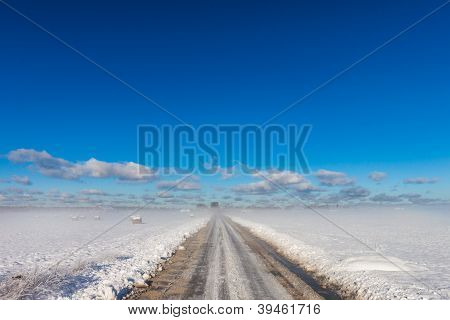 Snowy Road In Coutryside