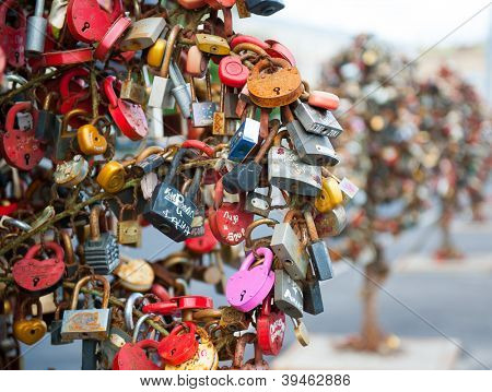Many padlocks hanging on Lugkov bridge in Moscow, Russia