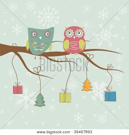 Christmas card with two cute owls on the tree branch